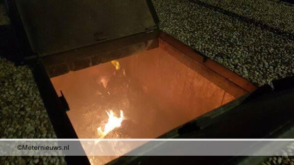papier container in brand Assen